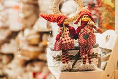 Rustic christmas toys, elves and gnomes gifts on window in europ stock photography