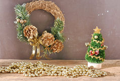 Rustic christmas tree ornament and decorations on wooden plank Royalty Free Stock Photos