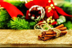 Rustic Christmas wooden background with cinnamon sticks Royalty Free Stock Photography