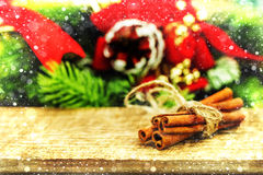 Rustic Christmas wooden background with cinnamon sticks Stock Photos