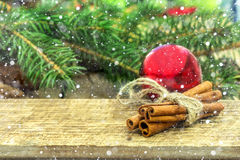 Rustic Christmas wooden background with cinnamon sticks Royalty Free Stock Photos