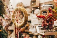 Rustic christmas wreath, elves and gnomes gifts on window  in eu stock photography