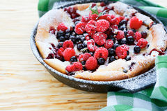 Rustic Clafoutis with fresh berries Stock Images