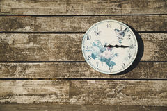 Rustic clock on wooden wall Stock Photography