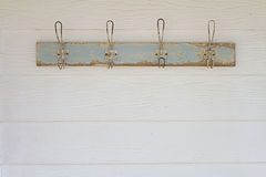 Rustic coat hooks background on white weatherboard house. Rustic coat hooks background on country white weatherboard house royalty free stock images