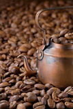 Rustic coffee pot with coffee beans Royalty Free Stock Images