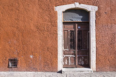 Rustic colonial style entry door Royalty Free Stock Photos