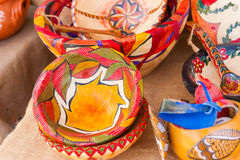 Rustic colorfully painted wooden bowls in traditional market. Colorfully painted wooden bowls in market Stock Images