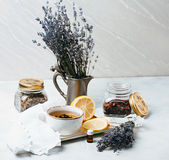 Rustic composition of tea, lavender, lemon and textile on concrete eco background. Royalty Free Stock Photos