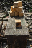 Rustic concepts, homemade wooden cubes Royalty Free Stock Images