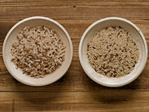 Rustic cooked and uncooked unpolished brown rice Royalty Free Stock Photography