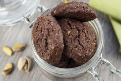 RUSTIC COOKIES COCOA AND PISTACHIOS. Inside a glass jar Royalty Free Stock Images