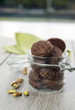 RUSTIC COOKIES COCOA AND PISTACHIOS. Inside a glass jar Stock Photo