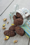 RUSTIC COOKIES COCOA AND PISTACHIOS. Inside a glass jar Royalty Free Stock Photography