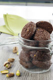 RUSTIC COOKIES COCOA AND PISTACHIOS. Inside a glass jar Royalty Free Stock Image