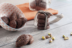 RUSTIC COOKIES COCOA AND PISTACHIOS. RUSTIC COOKIES COCOA STACKED AND PISTACHIOS Royalty Free Stock Photo