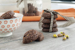 RUSTIC COOKIES COCOA AND PISTACHIOS. RUSTIC COOKIES COCOA STACKED AND PISTACHIOS Stock Photos