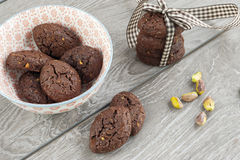RUSTIC COOKIES COCOA AND PISTACHIOS. RUSTIC COOKIES COCOA STACKED AND PISTACHIOS Royalty Free Stock Image