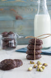RUSTIC COOKIES COCOA STACKED AND PISTACHIOS. WITH MILK GLASS Stock Images
