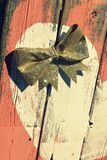 Rustic Coral Wood. With bow and heart Royalty Free Stock Photography