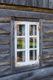 Rustic cottage window in old wooden rural house Stock Images