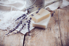 Rustic country background, natural soap. Lavender, salt and old cans on a wooden board, hygiene items for the bath and spa Stock Images