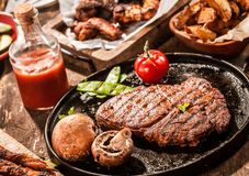 Rustic country meal of grilled rib eye beef steak Stock Image