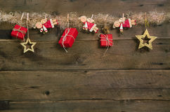 Rustic country style christmas background with red gift boxes an. D hanging angels Stock Photos
