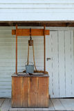 Rustic Country Well. Rustic wooden country well with metal bucket and rope on pulley stock photos