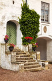 Rustic courtyard porch Stock Images