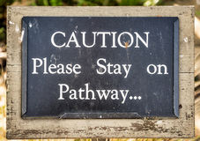 Coution Please Stay on Pathway.. Royalty Free Stock Image