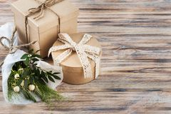 Rustic craft gift boxes with wild flowers stock image