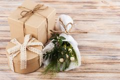 Rustic craft gift boxes with wild flowers royalty free stock photo