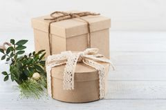 Rustic craft gift boxes with wild flowers royalty free stock images