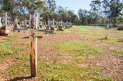 Rustic Cross: New Norcia Cemetery. NEW NORCIA,WA,AUSTRALIA-JULY 15,2016: Peaceful New Norcia Cemetery with gravestones in ordered rows with crosses, rustic cross Royalty Free Stock Photos