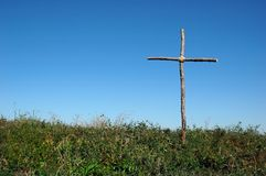 Rustic Cross over blue sky Stock Photography