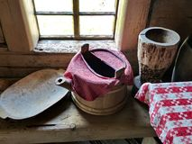 Rustic cuisine. Kettle with dishes on the table. Interior of a peasant izba. Closeup. Retro. Selective focus. Ural village. Museum-reserve of wooden stock photo