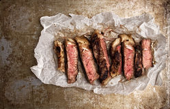Rustic cut juicy barbecue grilled steak Stock Photography