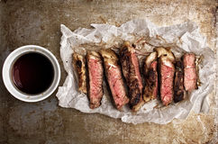 Rustic cut juicy barbecue grilled steak Royalty Free Stock Photos