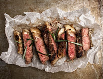 Rustic cut juicy barbecue grilled steak Royalty Free Stock Images