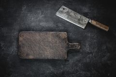 Rustic Cutting Board and Meat Cleaver on Dark Background. Butcher Shop Tool stock photos