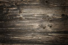 Rustic dark wooden planks with vignette lighting stock photos