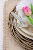 Rustic dinner setting with pink tulip Stock Photography