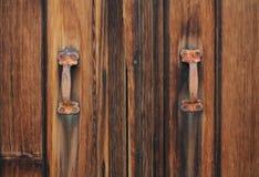 Rustic Door. Old rustic brown door with rusty handles and weathered wood stock photos