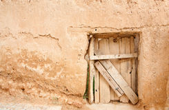 Rustic door and adobe wall Royalty Free Stock Images