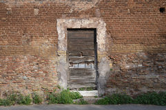 Rustic Door in Ancient Wall. A very old unused door inset into an ancient wall in Rome.  Photo taken April 2015 Stock Images