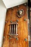 Rustic door with iron bar Stock Photo