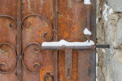 Rustic door lock snow Stock Image