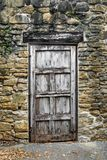 Rustic Door in Stone Wall royalty free stock photo