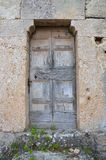 Rustic Door in Stone Wall Royalty Free Stock Photography